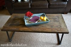 "#DIY pipe and wood coffee table that adds a great touch of ""shabby chic"" to any living room."