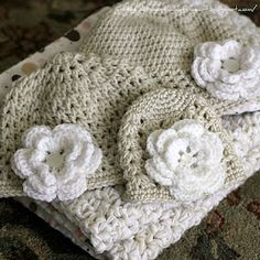 "small baby hat w/ flower. Free pattern w/ link to flower- instructions state ""may sell finished product""."