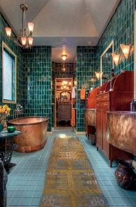 In the master bath, a copper soaking tub could almost be floating amid the watery setting of teal, green, and bronze tile. Kathryn designed the custom mahogany cabinetry and handmade copper sinks.