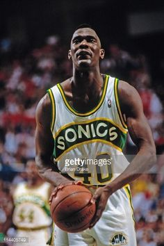 Shawn Kemp of the Seattle Supersonics shoots against the Portland Trailblazers at the Seattle Coliseum in Seattle Washington circa 1992 NOTE TO USER...