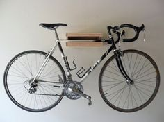 Since Chris Brigham of Knife & Saw debuted his smart and simple wood Bike Shelf last year, we've noticed lots of similar styles popping up on Etsy and other handmade sites. Most of them are crafted from a basic wood box with a groove to catch the bike frame and a ledge for additional storage.