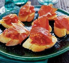 Spanish tomato bread with jamon serrano - mmmmm  4 ripe tomatoes , chopped  1 garlic clove , finely chopped  3 tbsp olive oil  salt  pepper  20 slices of baguette  5-6 slices serrano ham