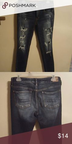AE distressed jeggings These have only been worn about 3 times. In excellent condition. Dark wash. American Eagle Outfitters Jeans Skinny