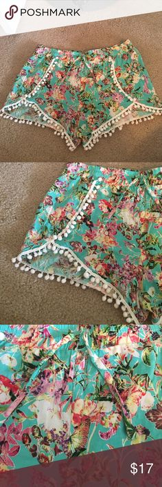 Floral printed shorts Cute little boho or hippie shorts with little tassle things at the bottom. Soft & comfortable! Stretch a bit at the waist band. Great condition, size large. Has draw strings EZ clothing Shorts