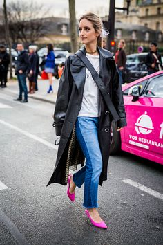 Charlotte Groeneveld fashion blogger from The Fashion Guitar wears a black Chanel trench coat a Dior black bag blue denim jeans pants and pink shoes...