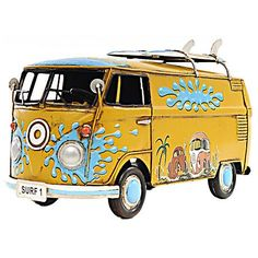 Peace and love is the name of the game with this reproduction 1967 Volkswagen Bus model car and authentic accessories.