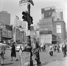 A salesman bides his time in Times Square, Manhattan, New York, Photo credit: Orlando / Getty — at Times Square, New York City.