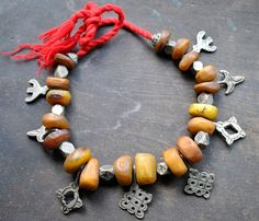 Africa | Vintage necklace (brought in Morocco in the 1980s) which combines large Amber beads, horn, silver spaces and silver amulets | The beads and pendants are a silver alloy and the amber, resin, not real amber beads.