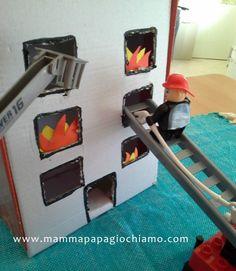 Edificio in fiamme! realizzato con una scatola di scarpe