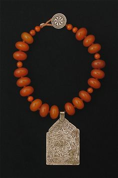 Amber necklace with antique silver pendant by Tamara Hill