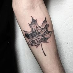 Lovely dotwork landscape in a leaf outline by Adam Thomas.
