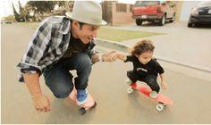 enjoying his little skateboard!  just love the kid's face ^.^