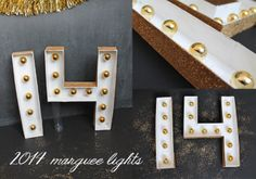 DIY 2014 marquee lights, using mini ornaments! #newyearseve