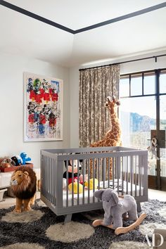 Patterns, prints and textures in gorgeous colourful nursery with grey rug, artwork and white walls