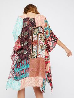 Voodoo Child Patchwork Kimono | Boho-inspired kimono featuring a pretty mixed print patchwork design.    * Lightweight, semi-sheer fabrication   * Lightly frayed hem for a lived-in look   * Easy, drapey shape