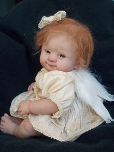 Polymer clay babies can be a bit freaky, but this one is real cute. DABIDAInstitute of Doll Artists