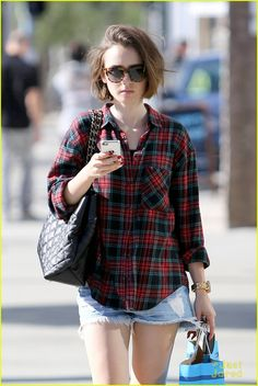Lily Collins enjoys the and sunny weather while doing some holiday shopping on Tuesday (December 9) in West Hollywood, Calif.