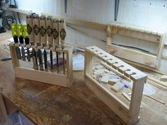 Movable Chisel Holders, easily adaptable for hanging chisels in the tool cabinet and removable.