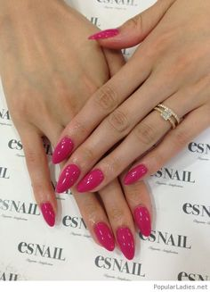 Perfect almond pink nails design with a gold ring