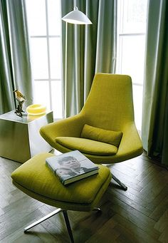 Love the color and the design of this chair....a modern take on the Womb Chair by Saarinen. Styled by Dutch interior designer, Kate Hume.