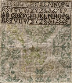 A Quaker Needlework Sampler, early 19th century, cross-stitch sampler worked in silk threads on a linen ground, embellished with alphabet panels above a central floral motif surrounded by geometric half medallions, in shades of green, yellow and pink, (imperfections), 12 x 10 1/2 in., unframed. Skinner 6/5/05