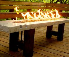 Delight guests with a light show as you keep them warm on a chilly night by gathering them around the fire pit table. It features a stylish and sturdy concrete and wood frame that make it ideal for outdoor use, and can easily be lit and turned off for added safety.