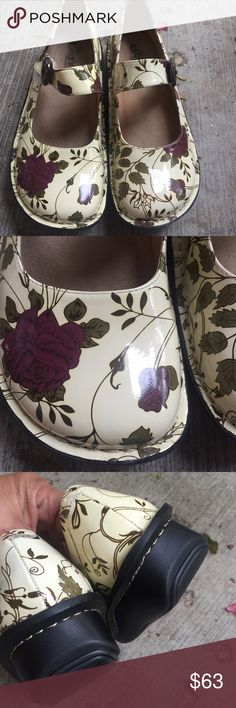Alegria Paloma White Rose Mary Jane NWOT Shoe has greenish gray leaves with wine colored roses. Gold stitching. Large wooden button on Velcro closure. New without box. Alegria Shoes Mules & Clogs