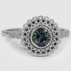 Alvadora ring blue green sapphire----I absolutely love the color of the center stone and the setting and style of this ring are just stunning!  *Trisha