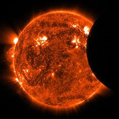 Moon crosses in front of sun, creating a partial solar eclipse visible only from space. Image from NASA's Solar Dynamics Observatory.