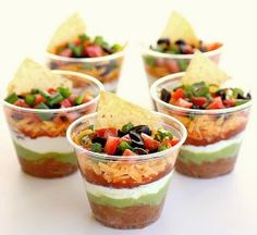Check out the recipe for these Party Perfect 7 Layer Dips, plus 12 more must-make dishes for your New Year's party!