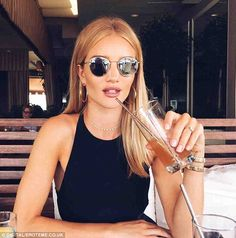 Fancy: On Tuesday, Rosie shared a stunning shot of herself while at lunch; the model wore a halter top with a gold choker and hoop earrings