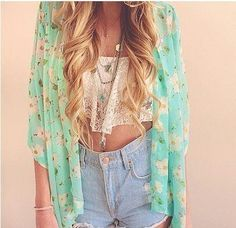 Blue light high waisted shorts, white flowy crop top and blue sunflower oversized sweater