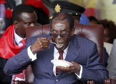 Zimbabwe's President Robert Mugabe eats cake at his birthday celebrations at Great Zimbabwe in Masvingo Zimbabwe, Birthday Bash, Citizen, Vows, Presidents, In This Moment, Celebrities, Pictures, Inspiration