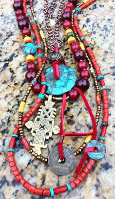 Mongolia Necklace: Exotic Red and Yellow Resin Amber, Bronze Glass, Turquoise Disc and Ethiopian Cross Necklace $325