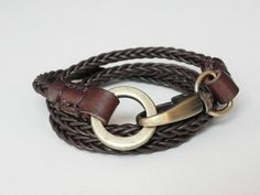 Leather Bracelet Brown Braided Leather Cuff Wrap Bracelet with Alloy Brass Tone Clasp Hand Stitched. $14.00, via Etsy.