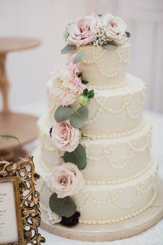 Rustic floral topped wedding cake: http://www.stylemepretty.com/2016/03/31/rustic-white-sparrow-barn-wedding/ | Photography: Shaun Menary - http://shaunmenary.com/