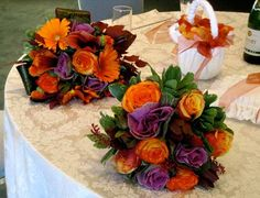 Wedding bouquets of orange and purple flowers consisting of orange roses with orange gerberas unique harvest brights