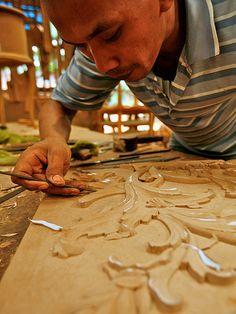 Furniture Worker.A man carve a furniture. Jepara, Central Java, Indonesia, June, 2009.