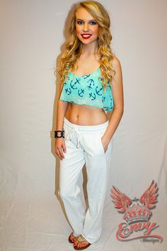 Blinded by the Sea Crop Top - Flirty yet sweet in an aqua ruffled crop top tank. A vibrant shade of aqua allows navy and off white anchors to pop off the the fabric in this nautical piece. Perfect for a fun look at the beach or by the pool with cutoff shorts.  - available online at http://www.envyboutique.us/shop/blinded-bythe-sea/ #Envy #Boutique #chic #fashion #fashiontrends #AquaCropTop, #NauticalCropTop, #PrintedCropTop
