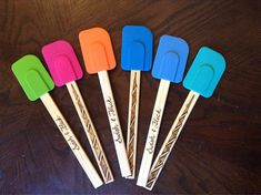 Colored silicon spatulas with wooden handles. Handles have been wood burned with Harry Potter themes. Sold as individual spatulas. Wood burning is all done by hand.