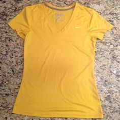 Small gold Nike Dri-fit v-neck workout tank Small gold Nike Dri-fit v-neck workout tank in EUC.  NO TRADES Nike Tops Tees - Short Sleeve