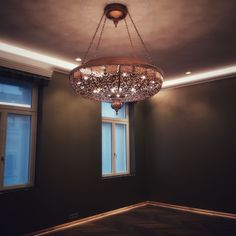 Bespoke Laser-Cutter oriental Hanging Lamp in Dark Bronze Patina Finish for a meditation room in a luxury apartment in the city center of Vienna. Dark green walls create a unique ambience for relaxation. Chandelier is 120 cm in Diameter and over 100cm high. LED bulbs in warm-white 2700K give the perfect light for this room. Bronze Patina, Patina Finish, Dark Green Walls, Luxury Apartments, Light Decorations, Vienna, Bulbs, Bespoke, Oriental