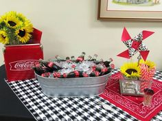 Coca-Cola in bottles with paper red/white striped straws for a 4th of July Birthday Party: