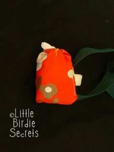 sew a little bag that fits over the leash to carry poop bags in!
