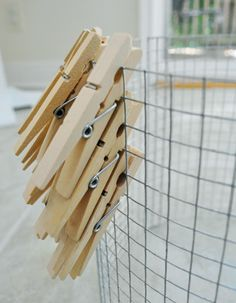 DIY clothespin chandelier for the laundry room.  I have pinned this before but then I saw rit dying the pins, could be a fun addition to the project