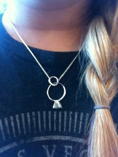 Necklace ring holder.  Tiffany & Co. Charm enhancer necklace  Like this.