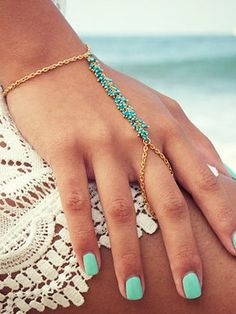 When a boho glam look is what you're after, wearing this gold turquoise beaded slave bracelet can do the trick.