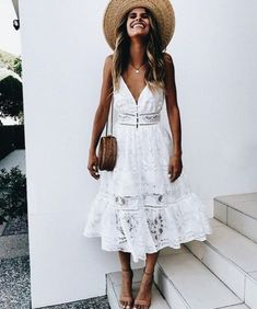 Keep it fresh with a summery white dress paired with a straw bag | Boho Chic Outfits for Every Occasion