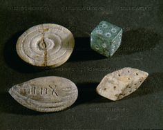 Dice, bone and bronze, a piece for draughts; bone and almond shaped theatre ticket; bone, engraved, probably from the theatre of Herod in Caesarea. Roman, Bar Kochba Period (1st and 2nd CE)   Reuben and Edith Hecht Collection - University, Haifa, Israel