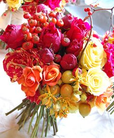 Bittersweet berries, rose hips and crab apples add a whimsical movement to this bouquet of roses and asclepias